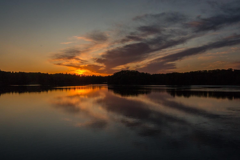 Solnedgång över Hjörneredssjön sedd från bron